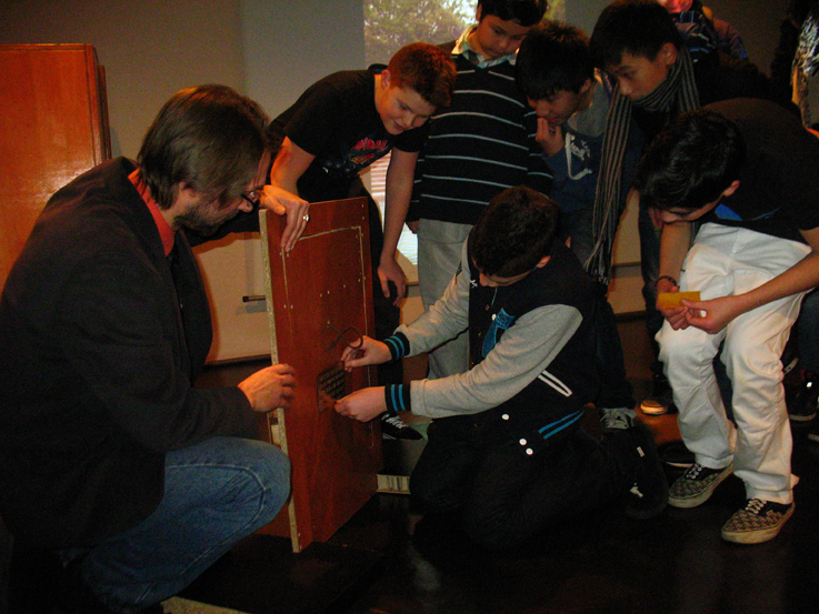 Group 1 affix the plaque onto the door they made with Jean-Olivier Gransard-Desmond's help